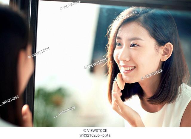 Young beauty makeup powder