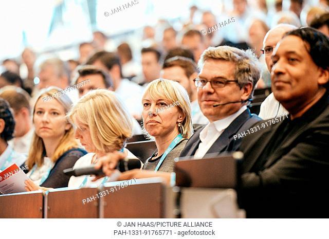 BAYREUTH/GERMANY - JUNE 21: Stefan Winners (Hubert Burda Media, 2.v.r.) and Cherno Jobatey (Huffington Post, r) smile in the audience listening to the speaker...