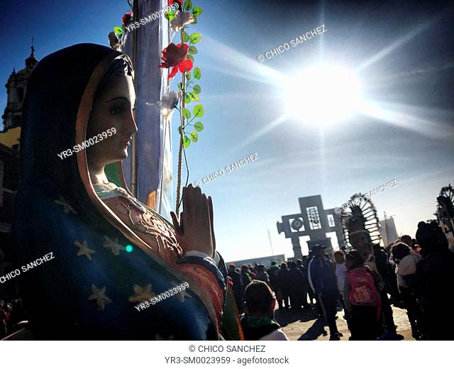 The sun shines over an image of the Virgin of Guadalupe during the annual pilgrimage to the Our Lady of Guadalupe Basilica in Mexico City, Mexico
