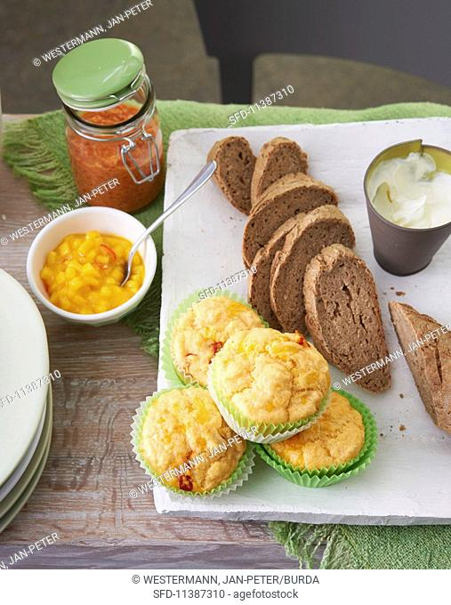 Bread with various dips and cheese and chilli muffins