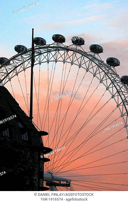 The London Eye seen at sunset in the heart of London, England, with Portcullis House, the annex of the Houses of Parliament in the foreground