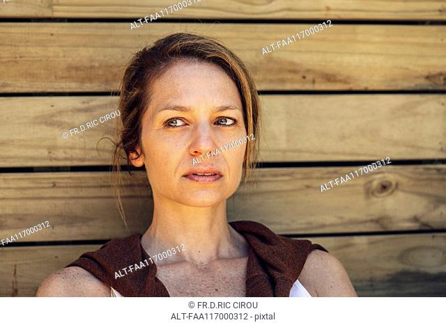 Mature woman sitting outdoors