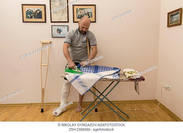 A man with a broken leg. Housework