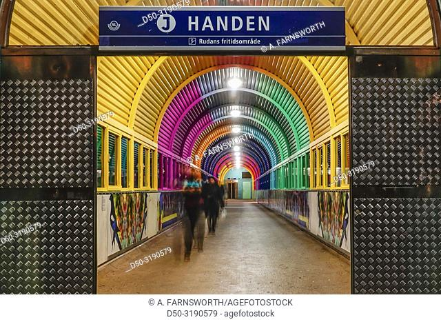 Stockholm, Sweden Pedestrians walk in the covered and colorfully painted passageway at the train station in the Handen suburb south of town