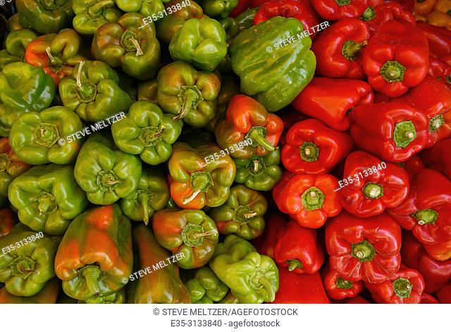 Piles of red and green peppers at a fruit and vegetable stand in Pezenas, France