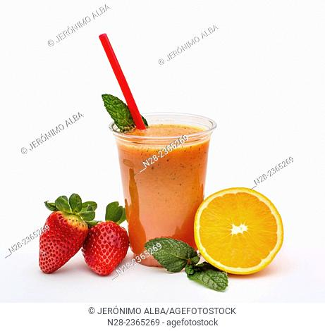 Fresh orange juice with strawberry and mint