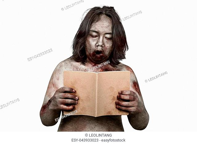 Portrait of zombie man reading the book posing isolated over white background