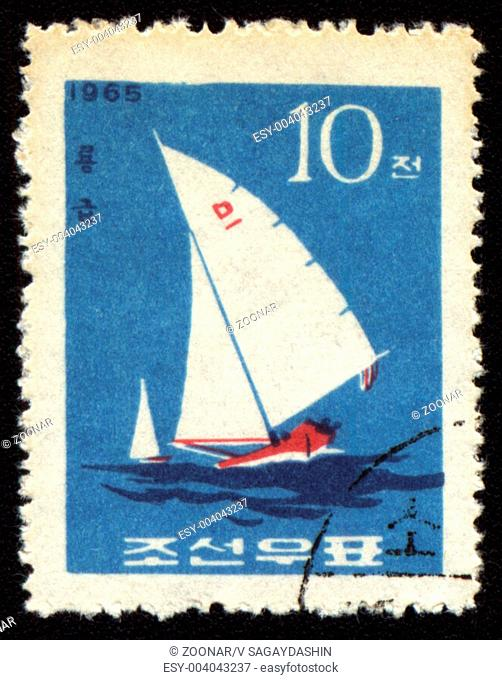 DPRK - CIRCA 1965: A stamp printed in DPRK North Korea shows yacht in a sea
