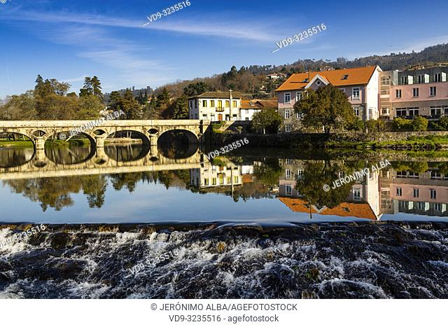 Ancient bridge, Vez river and village of Arcos de Valdevez. Viana do Castelo, Alto Minho region. Northern Portugal, Europe