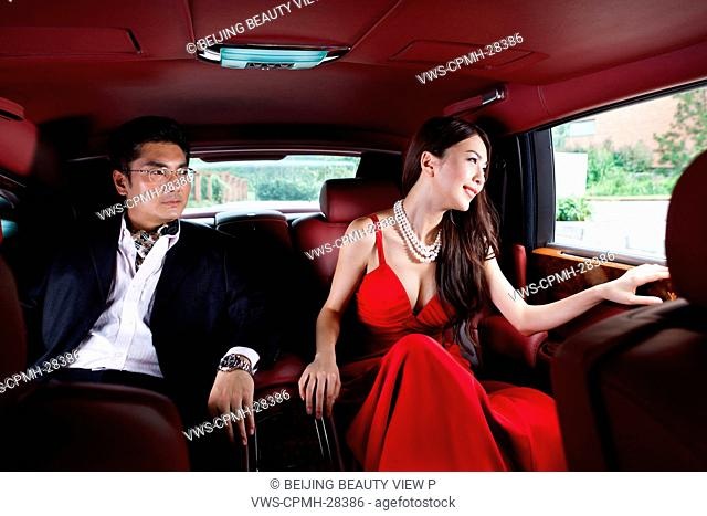 Young couple sitting in limousine