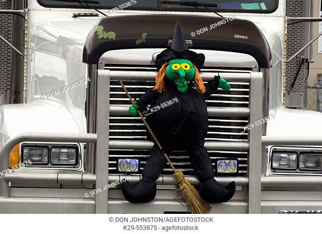 Witch mannequin 'embedded' in truck grill. Ontario