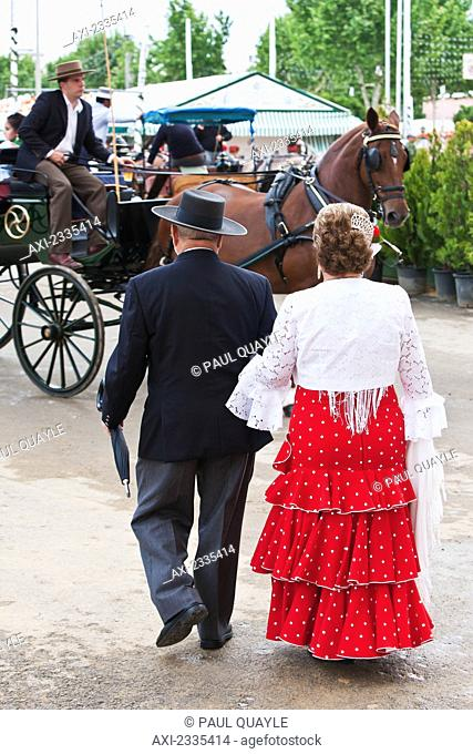 Woman in traditional Seville clothing at April Fearia Festival; Seville, Andalucia, Spain, Europe