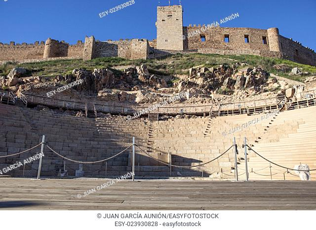 Roman theatre and Medellin castle, Spain. Low view from stage to grandstand
