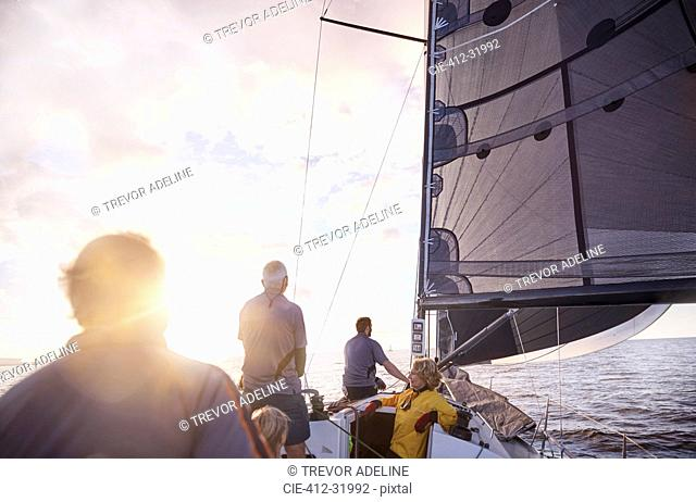 Friends sailing on sunny ocean