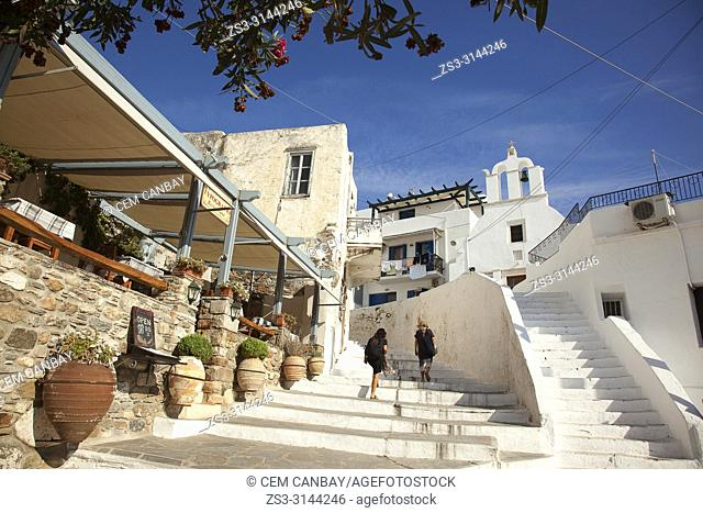 Tourists walking up the stairs in the old town Chora with a chapel at the background, Naxos Island, Cyclades Islands, Greek Islands, Greece, Europe