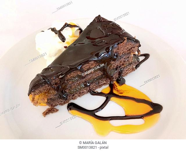 Chocolate cake with orange sauce and cream