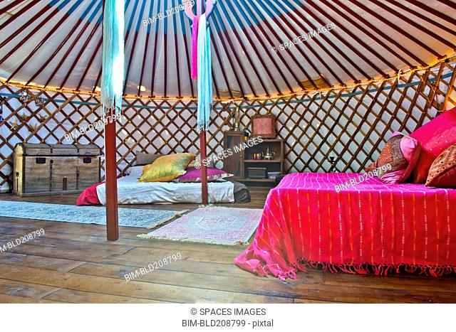 King sized double bed in a luxurious traditional Mongolia yurt