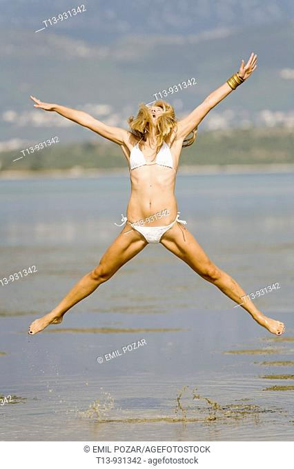 Young woman jumps high
