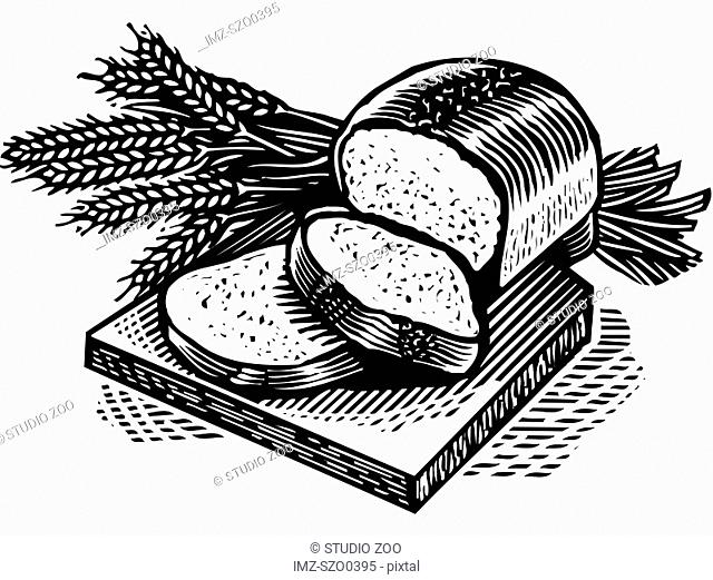 Sliced fresh bread and wheat stalks on a bread board, black and white