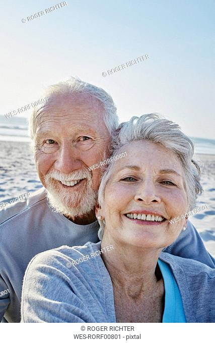 Portrait of smiling senior couple on the beach