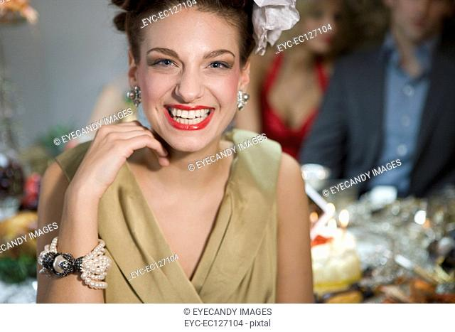 Portrait of smiling, glamorous young woman in vintage wear