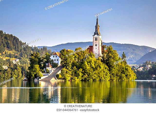 Famous Island with church in lake Bled in foggy light Slovenia Europe