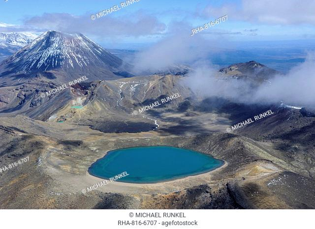 Aerial of a blue lake with Mount Ngauruhoe in the background, Tongariro National Park, UNESCO World Heritage Site, North Island, New Zealand, Pacific