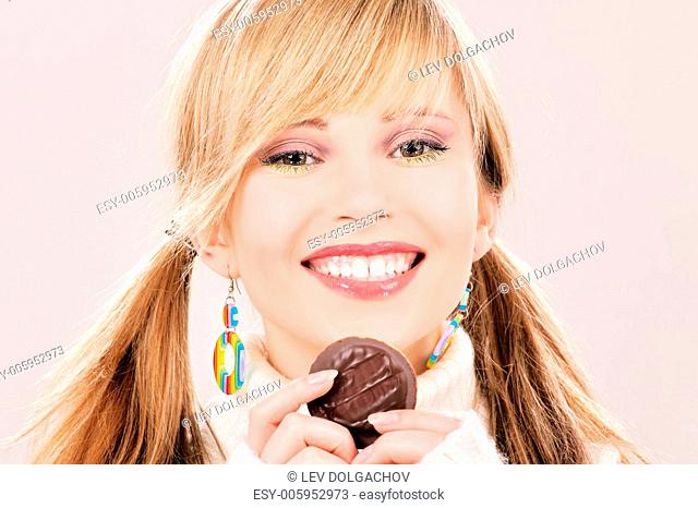 picture of happy teenage girl with cookie