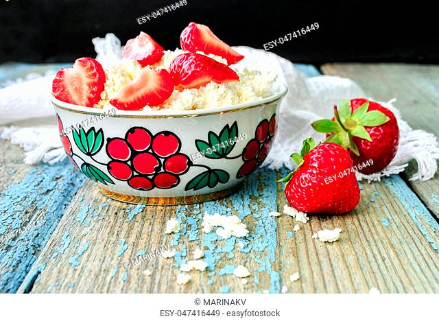 Cottage cheese with pieces of ripe strawberries, delicious and healthy food