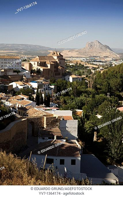 Partial view of Antequera highlighting the Iglesia del Carmen and the famous Peña de los Enamorados, Antequera, Andalusia, Spain