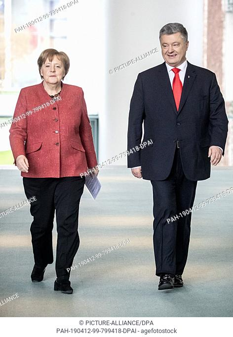 12 April 2019, Berlin: German Chancellor Angela Merkel (CDU) is coming to a press conference alongside Ukrainian President Petro Poroschenko after a joint...