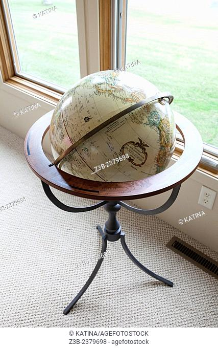Globe by the window at a home in Sanford Lake, Michigan, USA