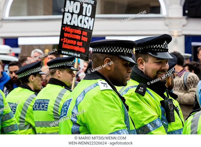 Large anti-racist march organised by UAF meets a counter demonstration by Britain First under the Eros statue in Piccadilly Circus Featuring: Atmosphere Where:...