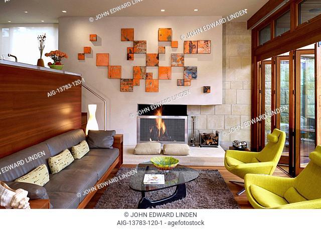 Split level living room with orange canvas art display in Odyssey House, Carmel, California, USA