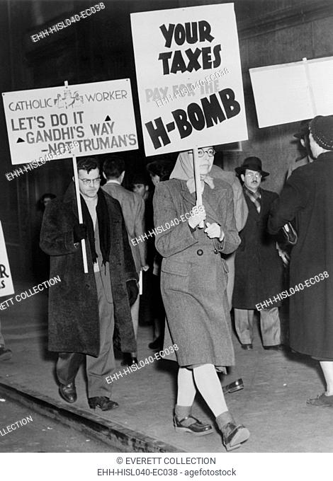 Men and women picketing against the use of tax dollars for the development of nuclear weapons. New York City, March 15, 1950. On Jan