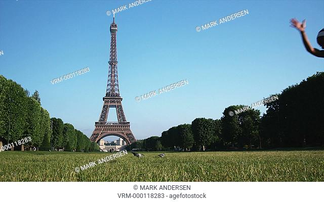 woman doing a cartwheel in front of the Eiffel tower