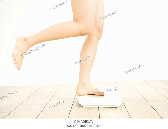 Woman getting on the scale