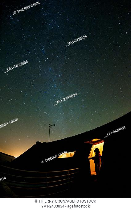 France, Finistere 29, Moelan sur Mer, man watching from roof Milky Way stars