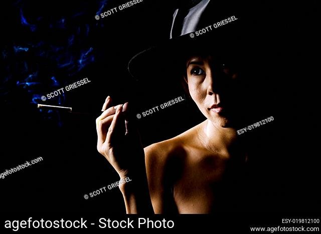 Woman in shadow wearing a black hat with