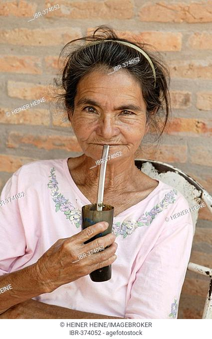 Guarani drinking mate tea out of a caiqua, in the