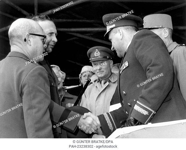 General H. I. Hodes (l), commander-in-chief of the US Army in Europe, welcoming the Soviet town major General H. F. Zakharov (r) during a parade on occasion of...