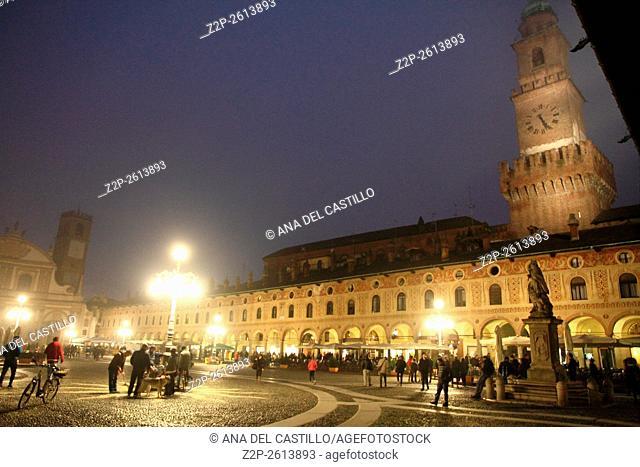 The Bramante clock tower in the Visconti-Sforza castle of Vigevano by night Italy