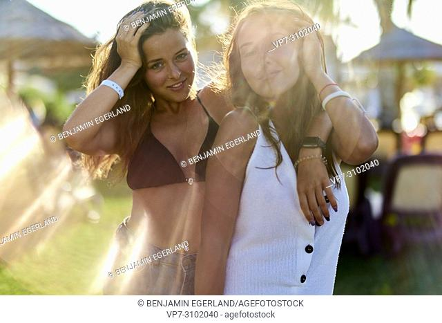 women in bikini at holiday resort, playful, sensual, togetherness, best friends enjoying summer