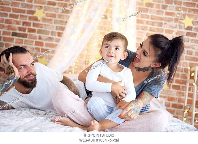 Happy family at Christmas time in bed