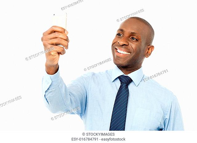 Cheerful businessman using big green calculator