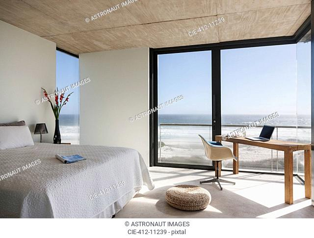 Modern bedroom overlooking ocean