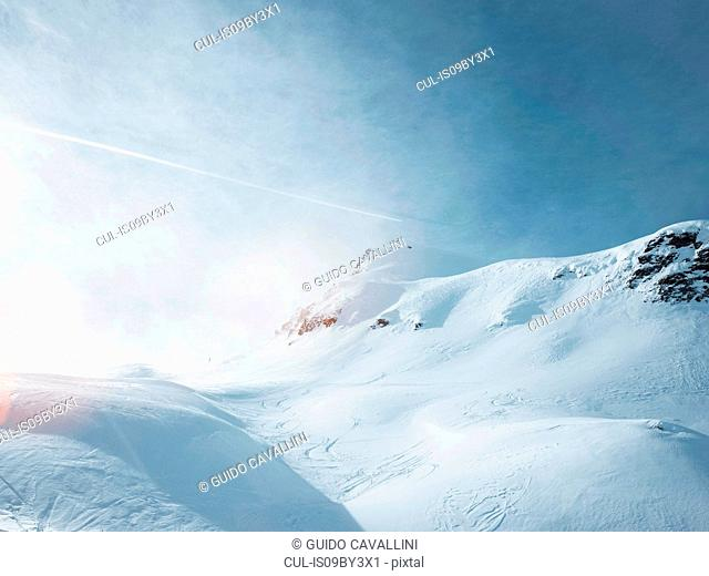 Sunlight in snow covered mountain landscape, Alpe Ciamporino, Piemonte, Italy