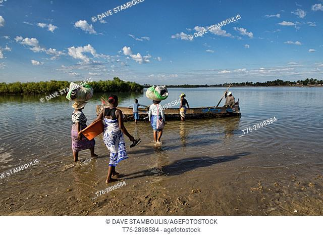 Ferry crossing by pirogue on an inlet off the Indian Ocean, Morondava, Madagascar