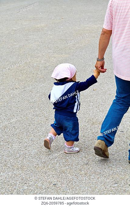 Man with little Child in Livorno in Tuscany, Italy