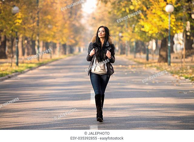 Young Woman Walking In Forest Through The Woods Outside During Autumn